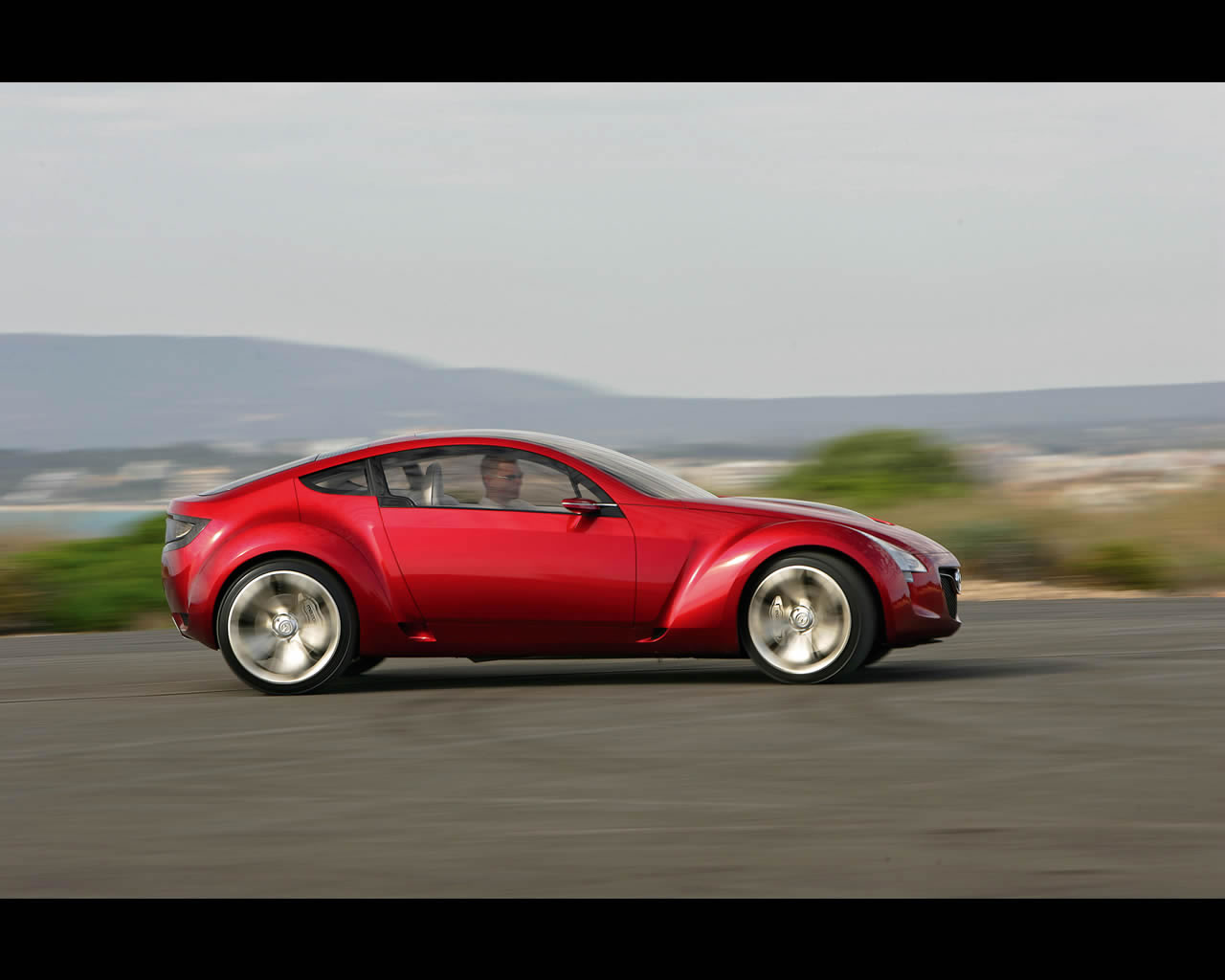 http://autoconcept-reviews.com/cars_reviews/mazda/mazda-kabura/wallpaper/Mazda_Kabura_2006_driving02_print.jpg