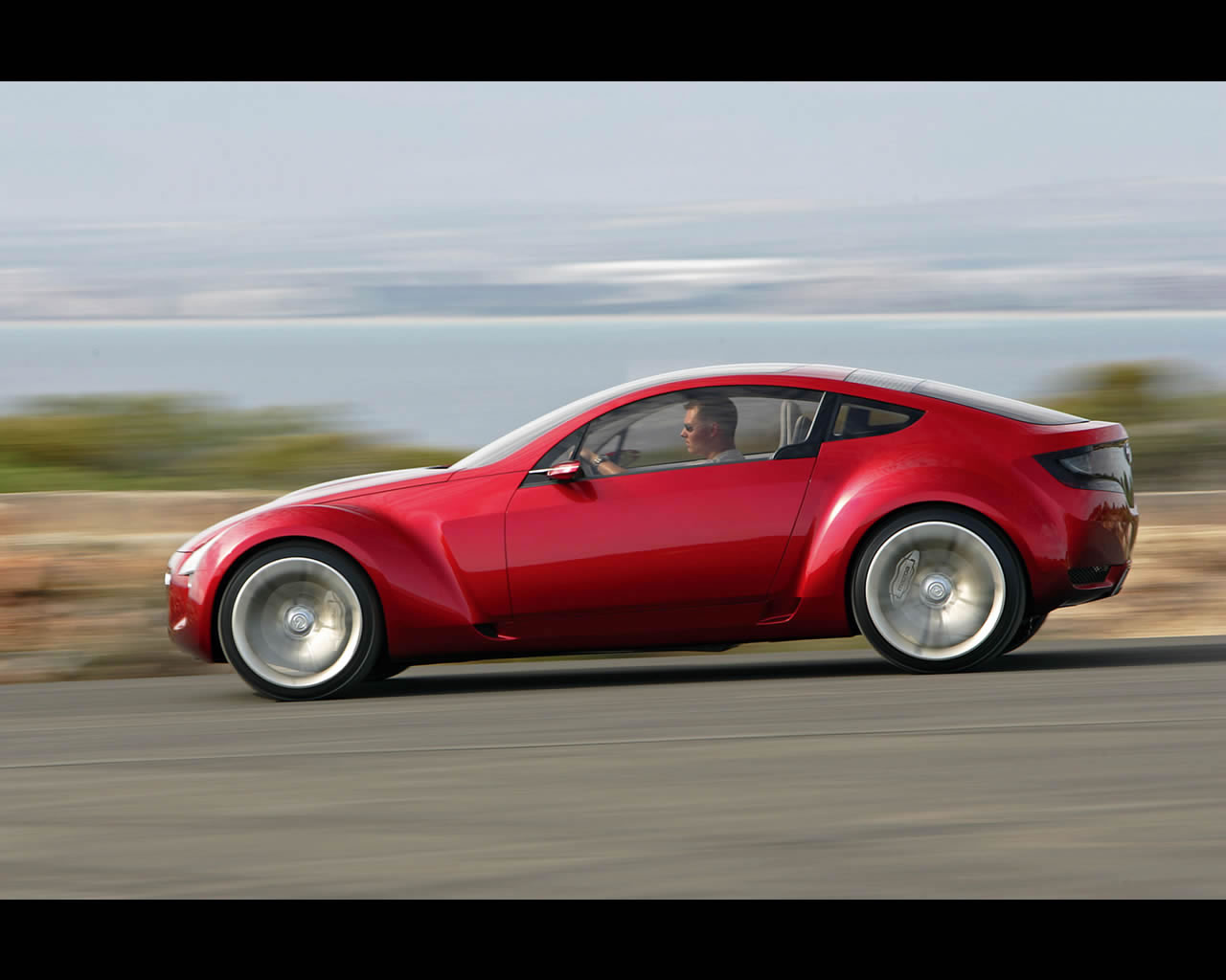 http://autoconcept-reviews.com/cars_reviews/mazda/mazda-kabura/wallpaper/Mazda_Kabura_2006_driving04_print.jpg