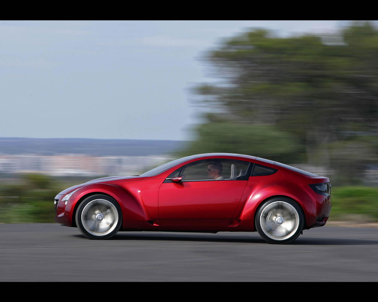 http://autoconcept-reviews.com/cars_reviews/mazda/mazda-kabura/wallpaper/Mazda_Kabura_2006_driving05_print.jpg